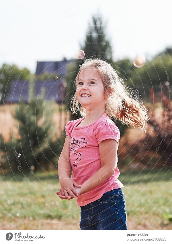 Little gir playing with soap bubbles Lifestyle Joy Happy Playing Garden Child Girl Infancy 1 Human being 30 - 45 years Adults Playground Authentic Happiness