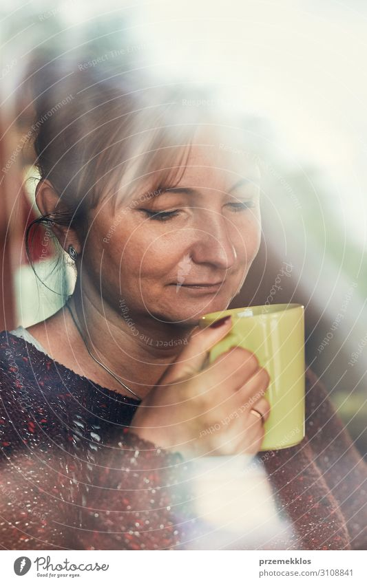 Portrait of woman drinking a coffee Woman Human being Youth (Young adults) Young woman Relaxation Adults Autumn Authentic Coffee Drinking Hot Tea 30 - 45 years