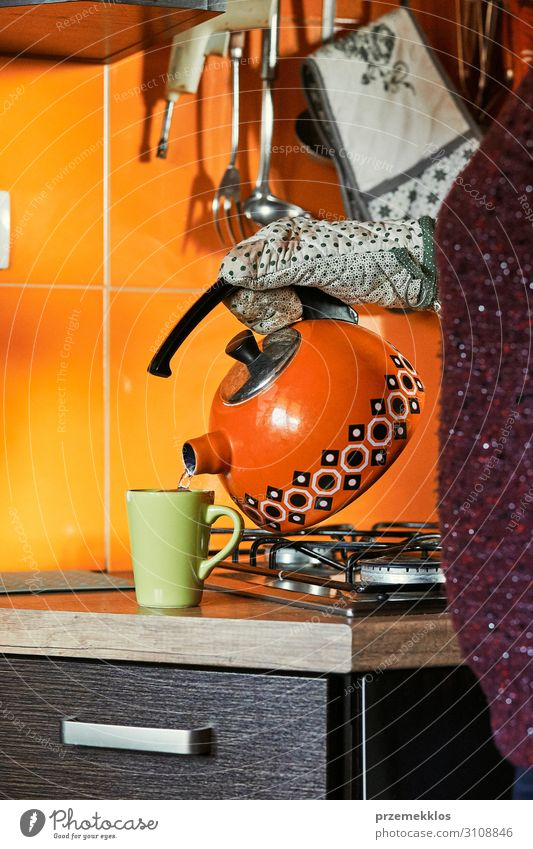 Woman pouring water to cup Breakfast Coffee Tea Pot Kitchen Adults 1 Human being 30 - 45 years Gloves Make Authentic Hot Modern Kettle mug preparing drink cook