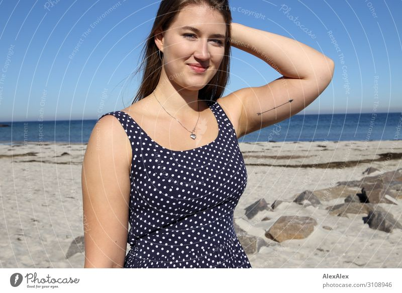 Portrait of a young, tall woman on the beach in a summer dress Style Joy already Life Well-being Summer Summer vacation Sun Sunbathing Beach Ocean Young woman