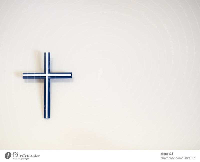 Blue and white catholic cross on a wall with copy space Easter Plastic Hope Death Belief Religion and faith background Catholicism christ Christianity