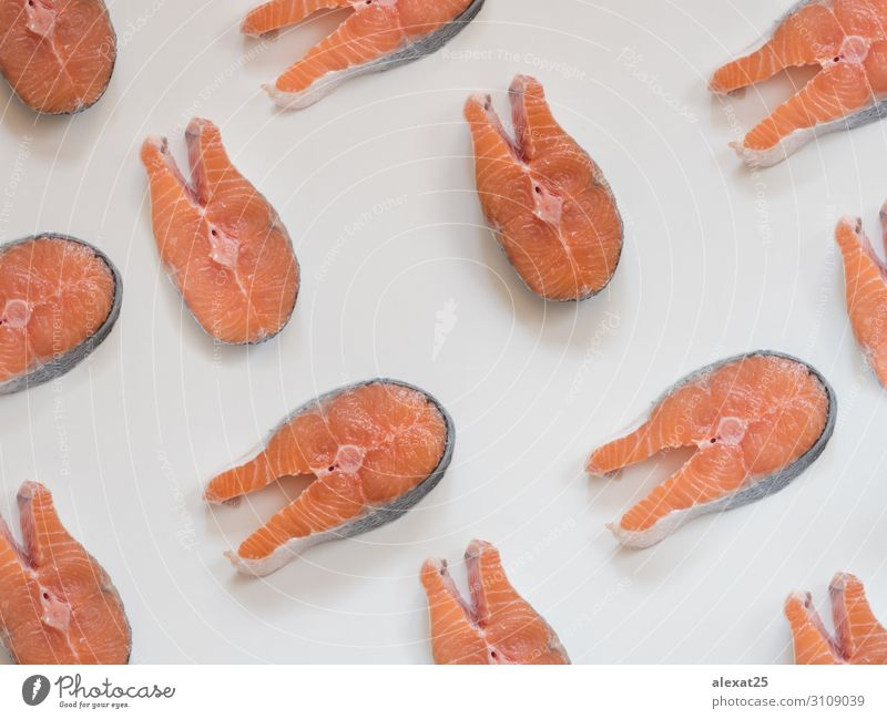 Salmon steak pattern on white background Seafood Ocean Fresh Natural Above Red White Conceptual design Cooking fat fish Gourmet healthy Ingredients isolated