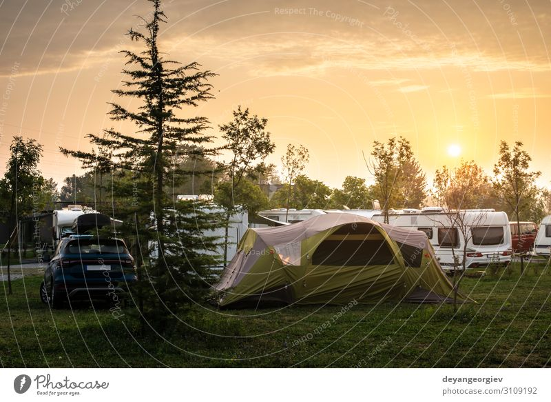 Caravans and tent on green meadow in campsite Joy Relaxation Leisure and hobbies Vacation & Travel Tourism Trip Adventure Camping Summer Sun Hiking