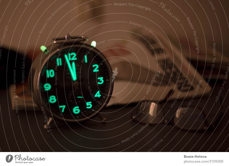 It's high time: Alarm clock with fluorescent numbers shows shortly before twelve Time Haste about time Fluorescent figures Night arrogance Midnight Eyeglasses