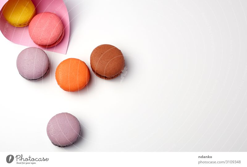 baked macarons in a pink paper bag Cake Dessert Candy Paper Fresh Delicious Above Brown Yellow Pink White Colour Tradition Almond assorted assortment background