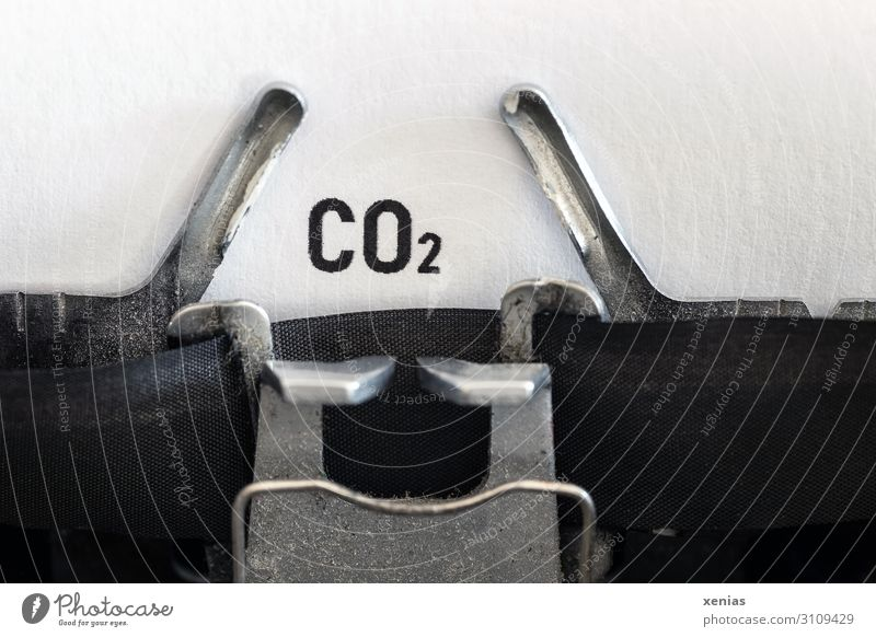carbon dioxide Science & Research Typewriter Energy industry Industry Environment Elements Climate change Stationery Paper Sign Characters Write Responsibility