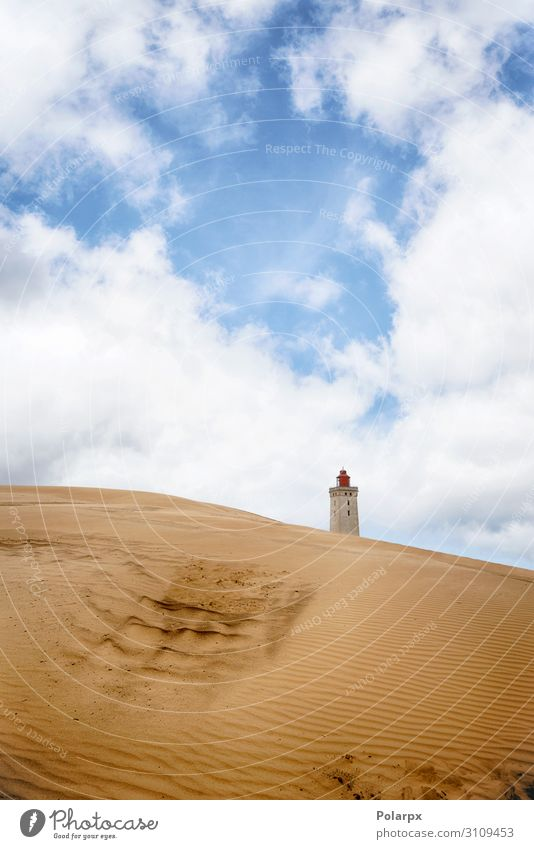 Lighthouse rising up behind a sand dune Beautiful Vacation & Travel Beach Ocean House (Residential Structure) Environment Nature Landscape Sand Sky Clouds Coast