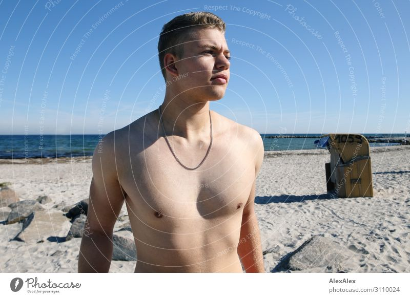 Portrait of a young, sporty man with free upper body on the beach Lifestyle Style Joy already Summer Summer vacation Sun Sunbathing Ocean Young man
