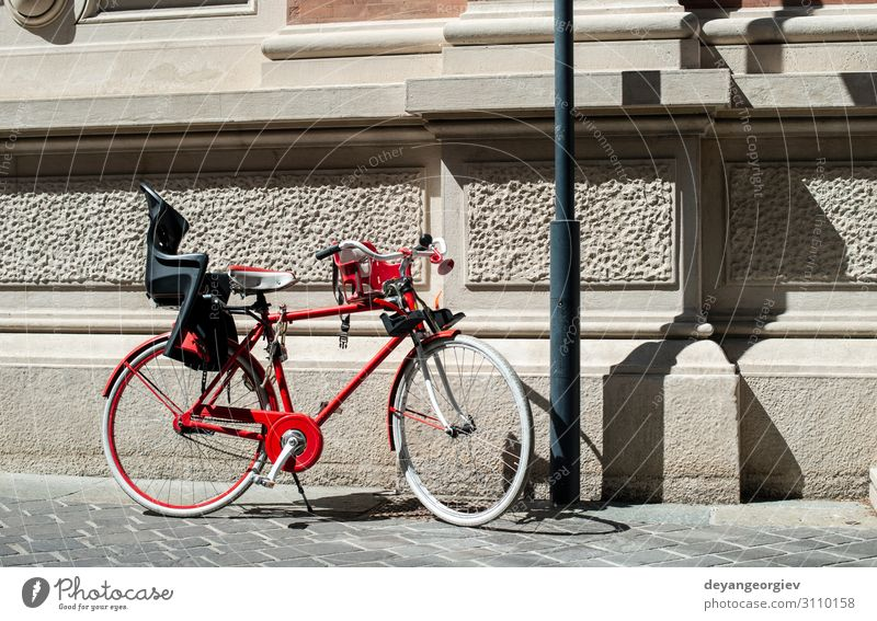 Red bike with basket on italian street. Lifestyle Style Relaxation Vacation & Travel Tourism Summer Sun Sports Cycling Town Transport Street Metal Old Retro