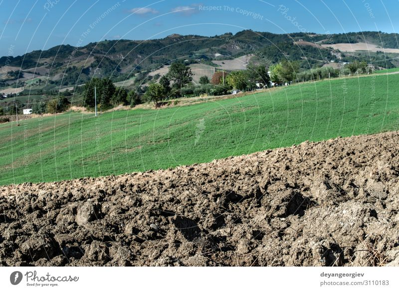 Ploughed soil close up. Sunny day. Environment Landscape Earth Meadow Hill Aircraft Brown Colour Plow agriculture Farm ploughed tillage Sowing