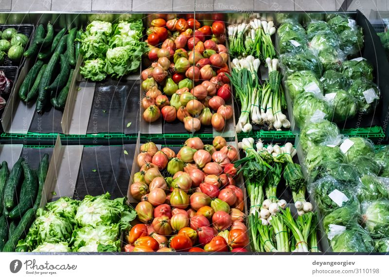Vegetables on shelf in supermarket. Food Shopping Marketplace Stand Sell Fresh Red Tradition Supermarket Greengrocer Customer Tomato Salad peppers Mature
