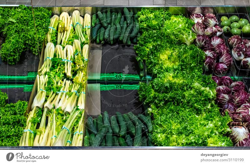 Vegetables on shelf in supermarket. Food Shopping Marketplace Stand Sell Fresh Red Tradition Supermarket Fennel Cucumber lettuce radicchio. Greengrocer Mature