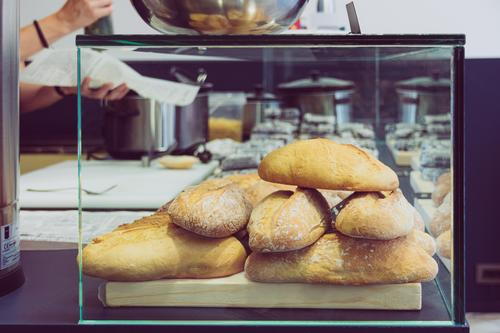 bread in snack shop and person working Food Bread Dessert Nutrition Lunch Lifestyle Shopping Beautiful Restaurant Work and employment Business Human being Woman