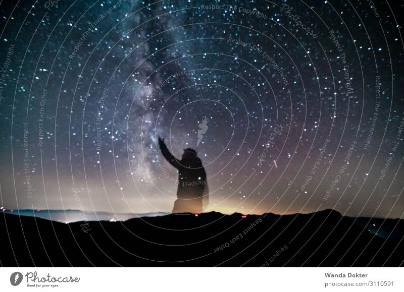Reach for the Stars Body 1 Human being Nature Landscape Air Sky Night sky Horizon Autumn Alps Mountain Observe Touch Discover Glittering Illuminate Study Hiking