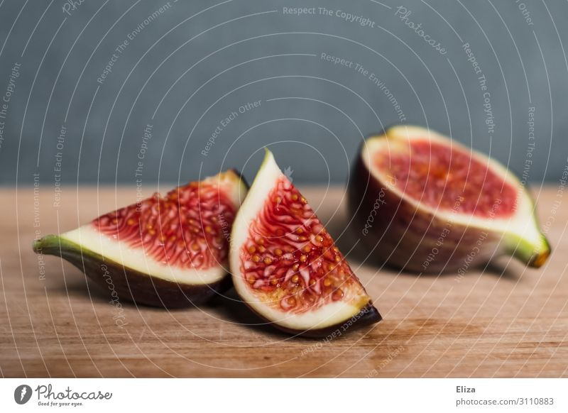 Sliced fig on wood Fig Delicious Juicy Fruit flesh fruit salubriously Nutrition Red