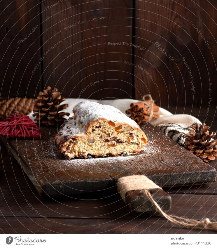 Stollen baked a traditional European cake Fruit Bread Cake Dessert Herbs and spices Winter Table Feasts & Celebrations Wood Delicious Brown White Tradition