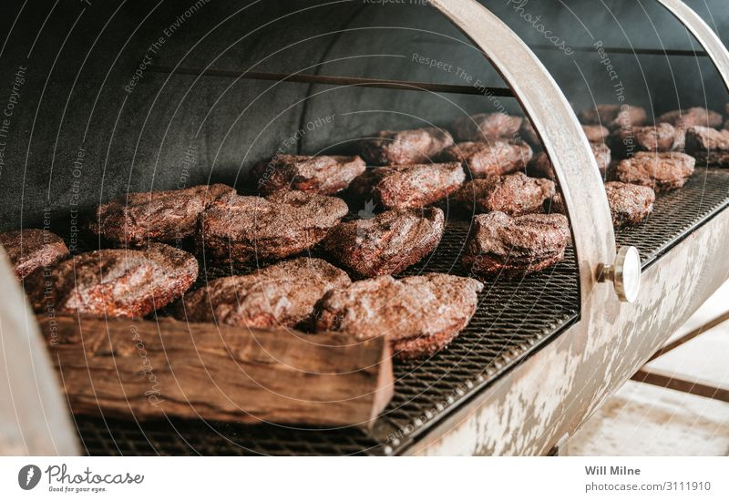 Briskets in a Smoker Beef Cow Meat smoker smoking Cooking briskets Food Dish Food photograph Dinner Barbecue (apparatus) Barbecue (event) BBQ Texas