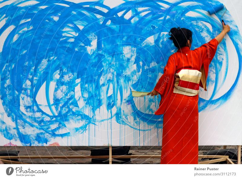 Woman in red kimono paints in blue Artist Feminine Adults Painter Work of art Kimono Black-haired Esthetic Blue Red Creativity creatively Inspiration