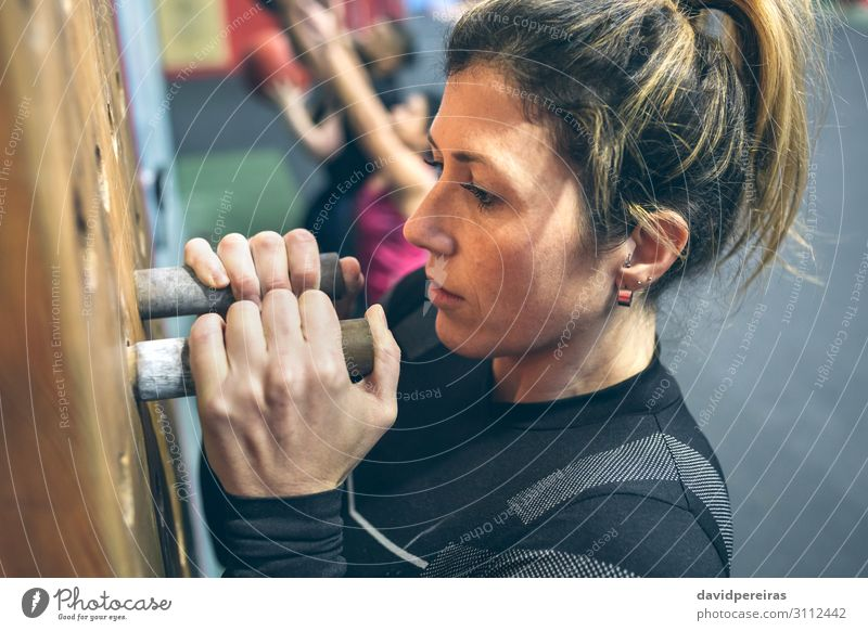 Woman hanging on the pegboard Lifestyle Body Sports Human being Adults Hand Fitness Athletic Authentic Strong Power Hang up cross fit endurance