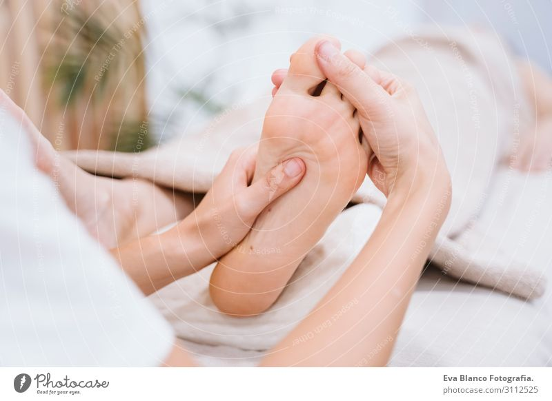 young Physiotherapist Woman giving a feet massage to patient Human being Youth (Young adults) Young woman Beautiful White Hand Relaxation Joy Healthy