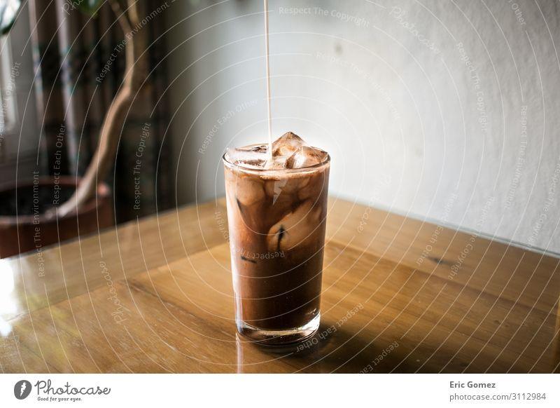Pouring milk into chocolate espresso iced coffee Chocolate To have a coffee Beverage Cold drink Milk Coffee Latte macchiato Espresso Glass Lifestyle Elegant Joy