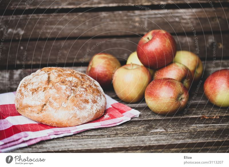 loaf of bread and crunchy apples on a wooden bench Food Apple Dough Baked goods Nutrition Picnic Organic produce Fresh Healthy Organic farming Delicious Bread