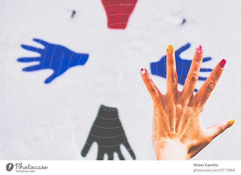 A hand with colorful nails with a painted hands background Lifestyle Shopping Luxury Elegant Style Exotic Joy Hand 1 Human being Esthetic Authentic Cool (slang)