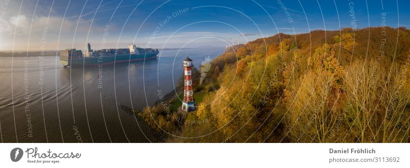 Lighthouse and container ship in Hamburg Navigation Nature Landscape Water Sky Autumn Tree Germany Europe Port City Container ship Illuminate Blue Yellow Gold