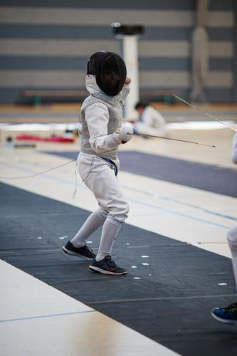 swordsman Lifestyle Sports Martial arts Sportsperson Fencing floret Human being Masculine Boy (child) Youth (Young adults) 1 8 - 13 years Child Infancy Clothing
