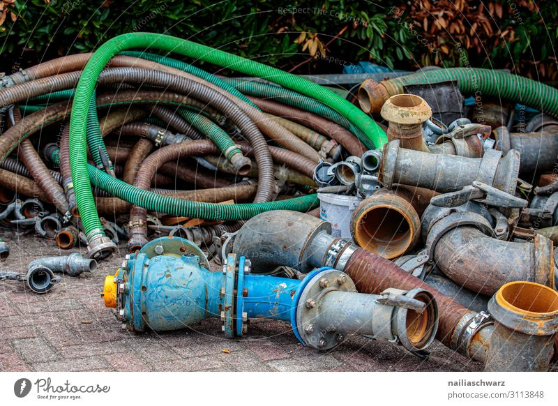 hoses Craftsperson Construction site Industry Technology Hose Conduit Pipe Metal Plastic Old Dirty Dark Simple Broken Blue Multicoloured Green Power