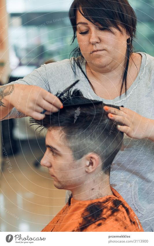 Hairdresser is haircutting styling young mans hair Lifestyle Shopping Style Hair and hairstyles Work and employment Profession Scissors Woman Adults Man 2