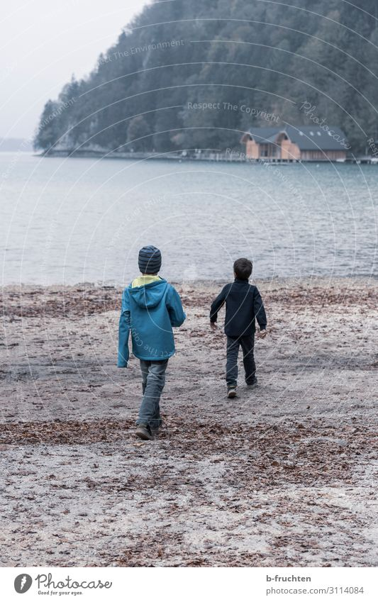 Two children on the lake shore Joy Harmonious Well-being Leisure and hobbies Playing Trip Adventure Freedom Hiking Child 2 Human being Clouds Autumn Bad weather