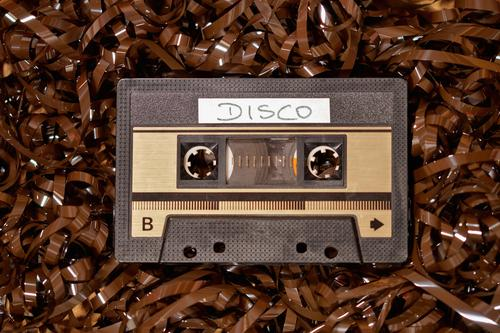 Music cassette 80s disco Hardware Tape cassette Audio tape Tape spaghetti Technology Collector's item Plastic Design Uniqueness Past Transience Change
