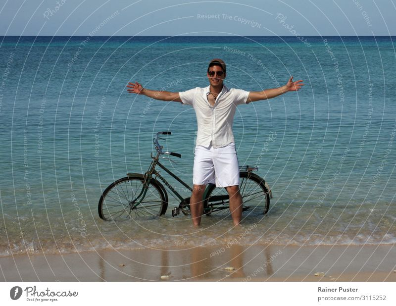 Young man with bicycle in the sea Cycling Bicycle Masculine Youth (Young adults) 1 Human being 18 - 30 years Adults Water Cloudless sky Sun coast Beach Ocean