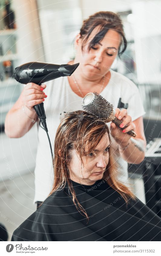 Hairdresser styling womans hair Lifestyle Style Beautiful Hair and hairstyles Work and employment Profession Scissors Brush Human being Young woman