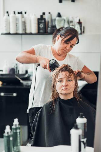 Hairdresser styling womans hair Lifestyle Shopping Style Beautiful Hair and hairstyles Work and employment Profession Scissors Human being Young woman