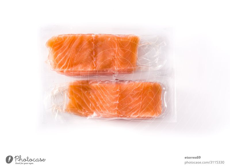 Salmon packaged in plastic isolated on white background Packaged Plastic Supermarket Food Healthy Eating Food photograph Fish Isolated (Position) Orange Raw