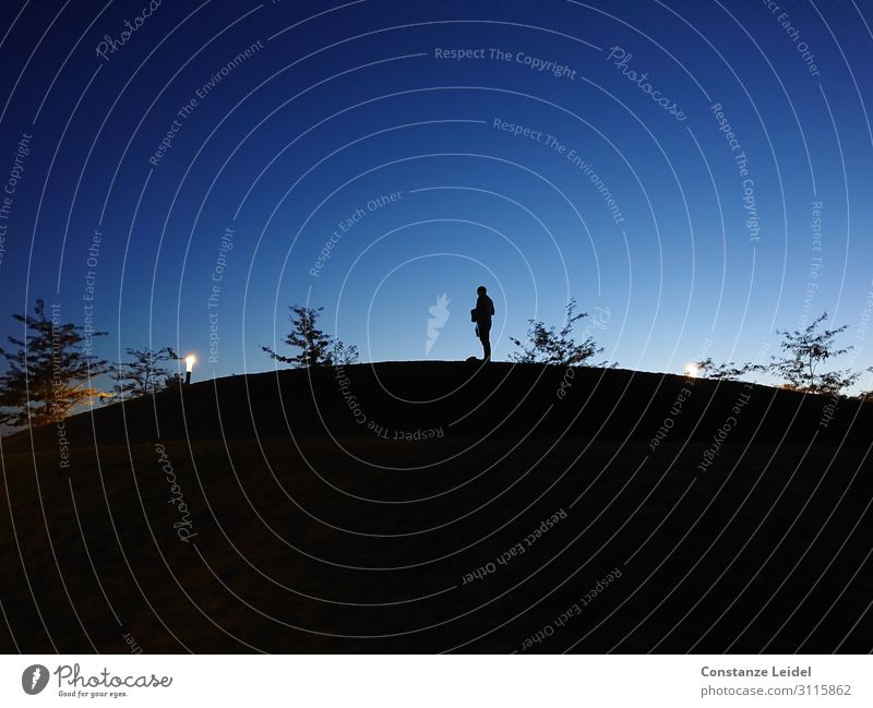 Blue hour Man Adults 1 Human being 30 - 45 years Sky Horizon Hill Illuminate Stand Black Moody Serene Calm Mysterious Identity Uniqueness Exterior shot