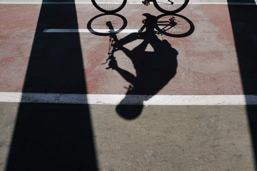 man on the bike shadow silhouette on the street Man Street Sports Leisure and hobbies Metal Transport Bicycle Cycling Ground Asphalt Object photography Wheels