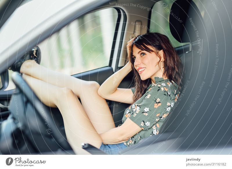 Woman resting in a white car pulling her feet out the window. Lifestyle Joy Happy Beautiful Relaxation Leisure and hobbies Vacation & Travel Trip Human being