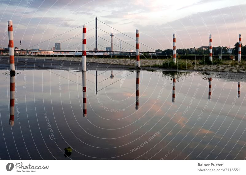 The skyline of Düsseldorf is reflected in a large puddle after the rain Sky Clouds Sunrise Sunset Duesseldorf Downtown Skyline Bridge Tower Landmark