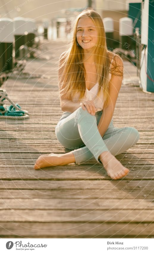 Young woman on jetty Joy Summer Feminine Girl Sister Family & Relations Friendship 1 Human being 18 - 30 years Youth (Young adults) Adults Harbour Love Maritime