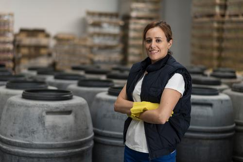 Worker woman Happy Work and employment Profession Factory Industry Human being Woman Adults Gloves Packaging Smiling Stand Employees & Colleagues olive food