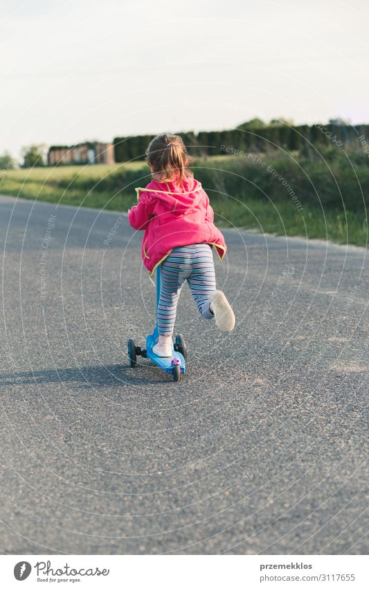 Young girl riding on roller skates Lifestyle Joy Happy Beautiful Relaxation Leisure and hobbies Playing Freedom Summer Summer vacation Ride Child Girl 1