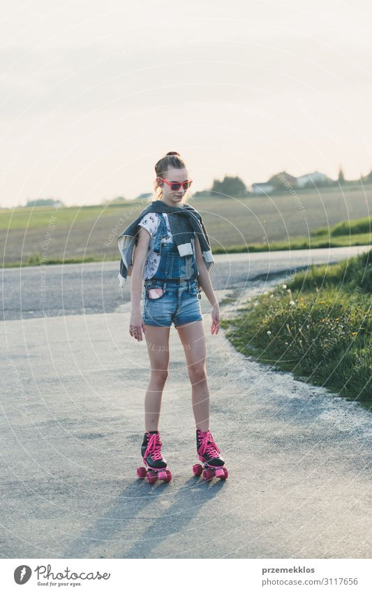 Young girl riding on roller skates Lifestyle Joy Happy Beautiful Relaxation Leisure and hobbies Playing Freedom Summer Summer vacation Ride Young woman