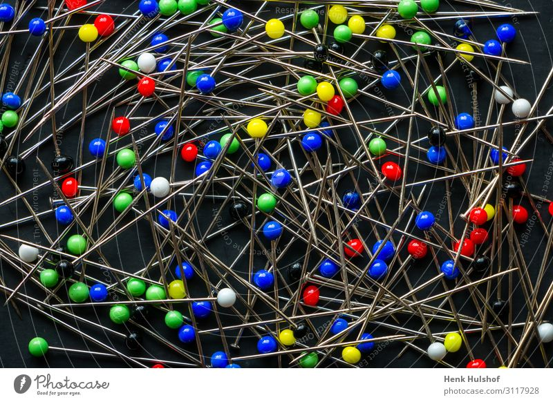 A bunch of multi colored round head pins on a black background Metal Plastic Blue Multicoloured Yellow Green Red White Sewing needle Sharp Steel Colour photo