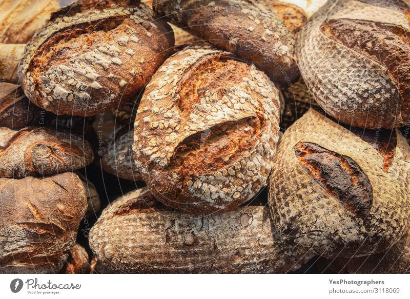 Rustic bread pile. Crusty bread background. Bakery products Food Dough Baked goods Bread Roll Nutrition Breakfast Tradition Baking basic food carbs colorful