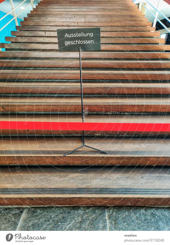 Exhibition closed Town Deserted Building Stairs Stand Brown Gray Red Signs and labeling Steps Barrier Closed Colour photo Interior shot Copy Space left