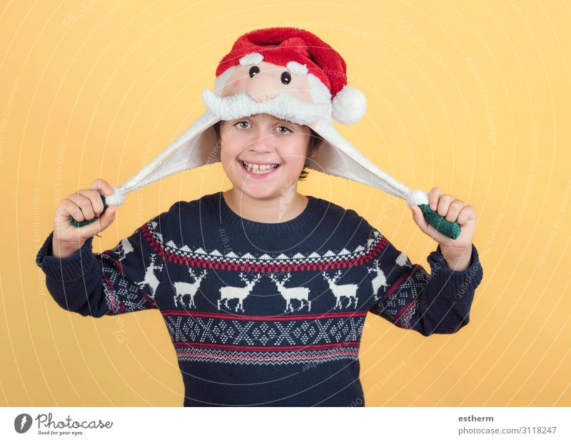 smiling Child Wearing Christmas Santa Claus Hat Joy Happy Winter Feasts & Celebrations Christmas & Advent New Year's Eve Human being Masculine