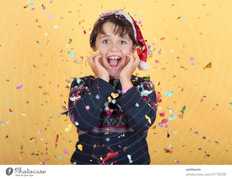 smiling child with confetti Wearing Christmas Santa Claus Hat Joy Happy Winter Feasts & Celebrations Christmas & Advent New Year's Eve Human being Masculine